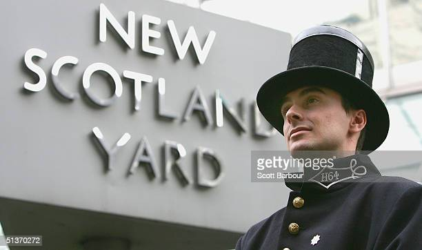 Police officer Alfred Peacock dressed in an 1829 Peelers uniform that dates from 1829 stands in front of the New Scotland Yard sign to mark the 175th...