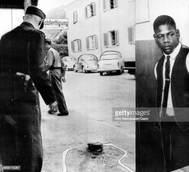 Police officer and a demonstrator shown with the chalk outline of a body during the Cambridge protests to end segregation Cambridge Maryland July 20...