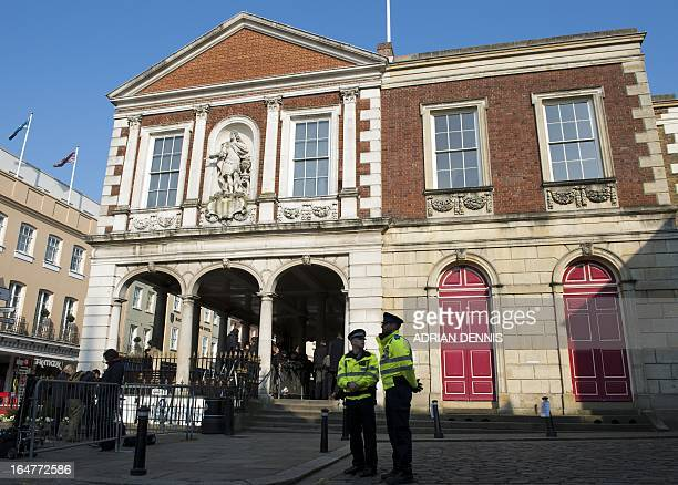 A police officer and Community Support Officer stand outside The Guildhall in Windsor on March 28 2013 ahead of an inquest into the death of Russian...