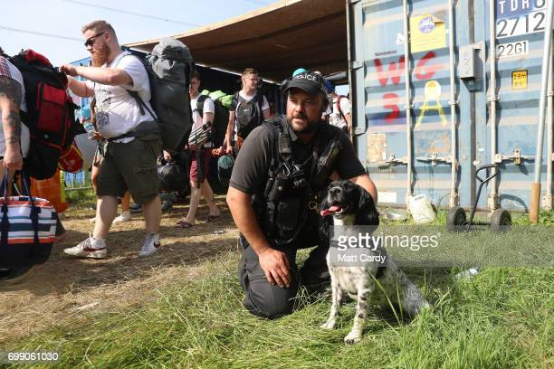 A police officer and his dog look on as the gates open at the Glastonbury Festival amid heightened security at Worthy Farm in Pilton on June 21 2017...