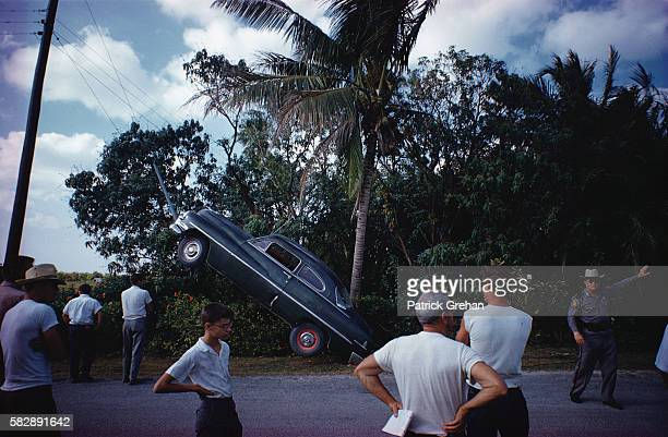 Police officer and onlookers gather at the scene of a car accident in Florida USA