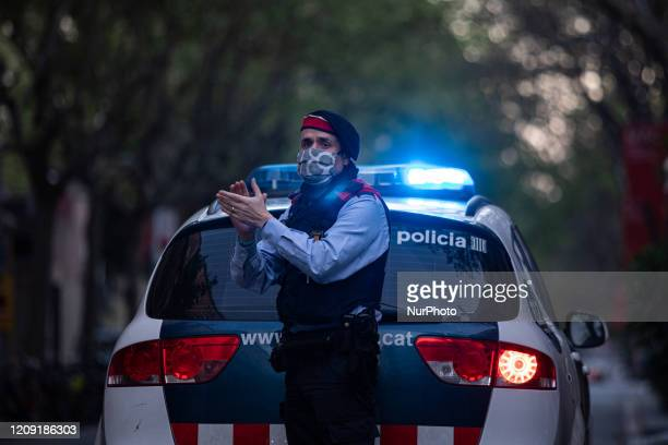 Police officer applause the nurses and doctors, in Barcelona, Spain, on April 5, 2020 during the Coronavirus Emergency.