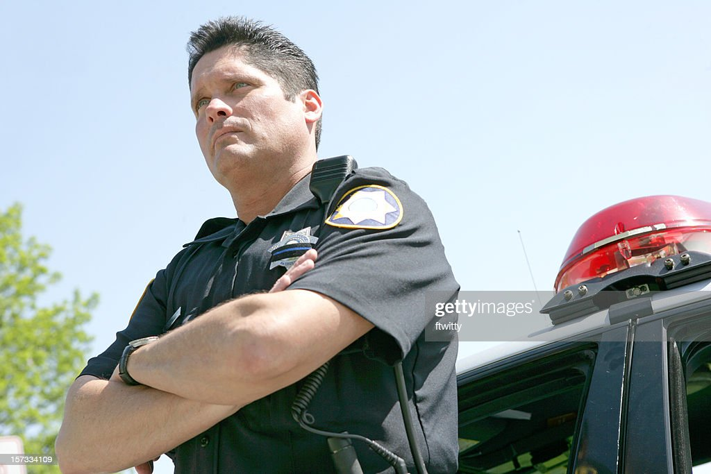 Police Officer Arms Folded : Stock Photo