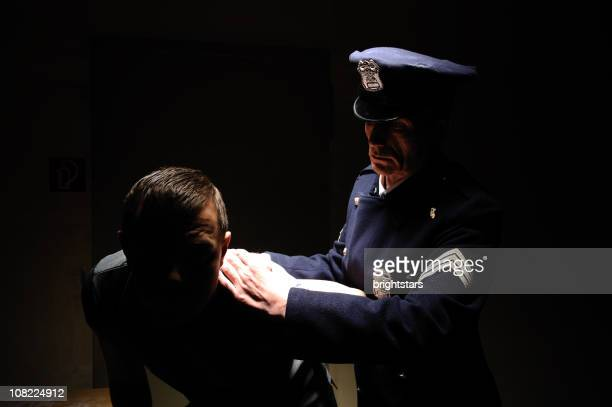 police officer arresting a man - prisoner photos stock pictures, royalty-free photos & images