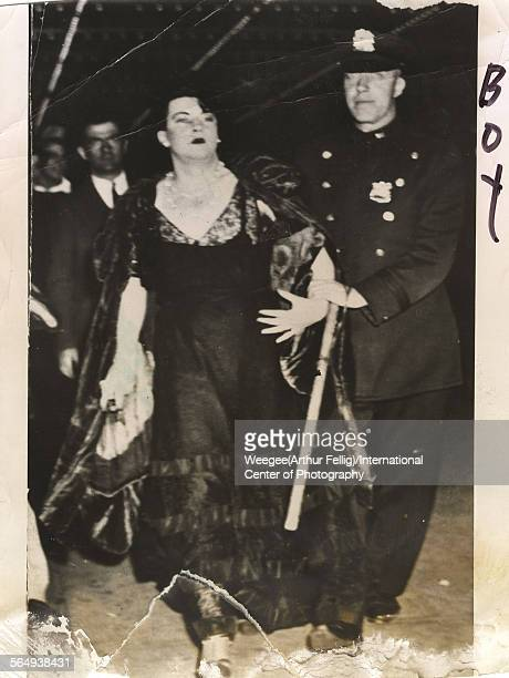 A police officer arrests a male crossdresser in a ball gown 1930s or 1940 Photo by Weegee /International Center of Photography/Getty Images