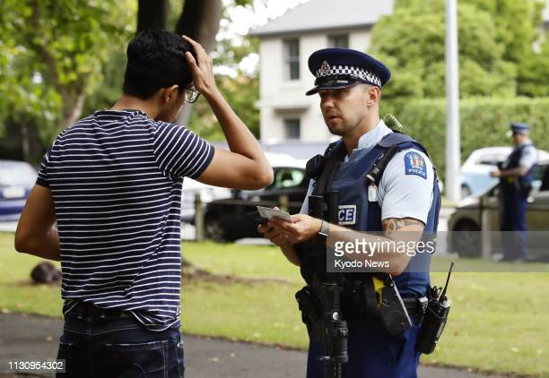 A police officer asks for identification near the Al Noor mosque in Christchurch New Zealand on March 16 following the deadly shootings ==Kyodo