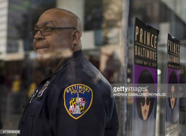 A police officer at a 'Rally 4 Peace' concert by Prince looks on in Baltimore Maryland on May 10 2015 Musical artist Prince is holding the concert in...
