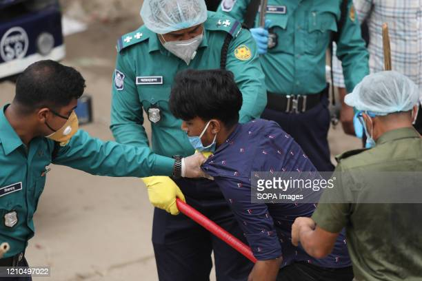 A police officer beats a man as a punishment for breaking the lockdown rules at the Bazar area Bangladesh has confirmed 2948 cases with 101 deaths...