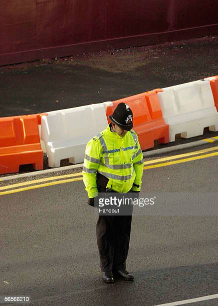 A police officer bows his head as the funeral cortege for Police Constable Sharon Beshenivsky arrives at Bradford Cathedral on January 11 2006 in...