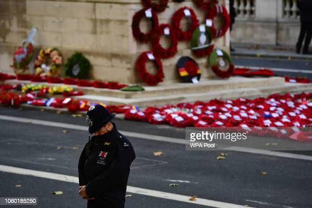 A police officer bows his head during the annual Remembrance Sunday memorial on November 11 2018 in London England The armistice ending the First...
