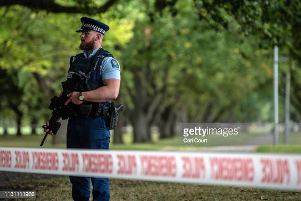 A police officer carrying an automatic rifle guards the area near Al Noor mosque on March 17 2019 in Christchurch New Zealand 50 people are confirmed...