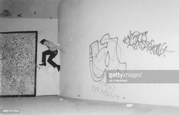 A police officer chases a suspect near Tompkins Square Park Alphabet City New York City circa 1980
