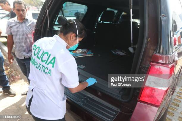 Police officer checks the car which brought former President of Peru Alan Garcia to emergency hospital Casimiro Ulloa after he shot himself to the...