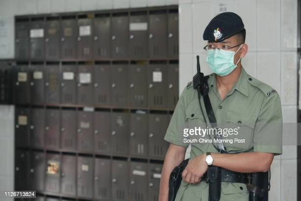 A Police officer conduct doortodoor visits to Mei On Industrial Building on Kung Yip Street during an antiburglary campaign in Kwai chung where the...
