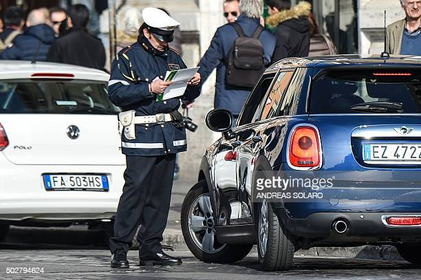 A police officer controls cars and scooters during the limited traffic day in centeral Rome on December 29 2015 A second day with limited traffic of...