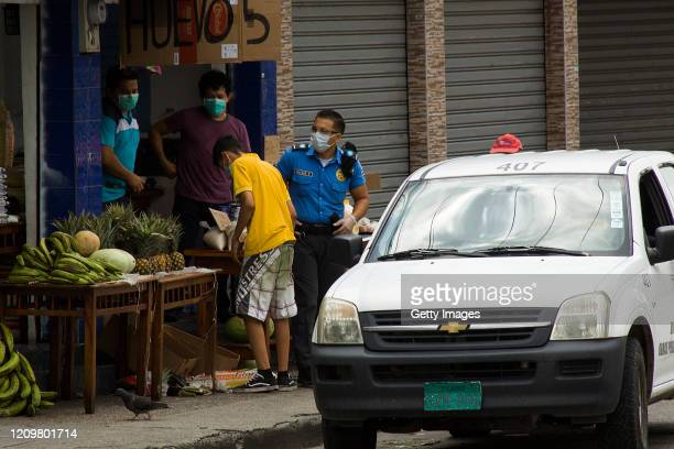 Police officer controls prices in products of first necessity on April 13, 2020 in Guayaquil, Ecuador. Guayaquil is the epicenter of the COVID-19...