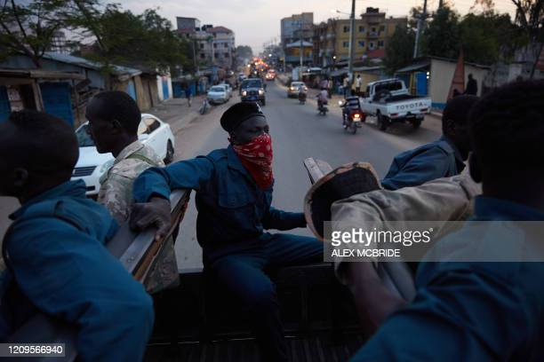 Police officer covers his face with material while patroling the streets of Juba, South Sudan on April 9, 2020. - South Sudanese police are enforcing...
