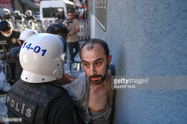 Police officer detains a protester during a rally, in the Kadikoy district, in Istanbul, on July 20 called to mark on the anniversary of the 2015...