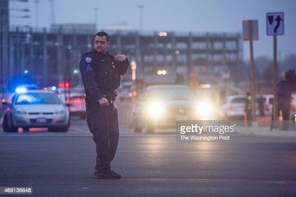 A police officer directed traffic along Silver hill Rioad after reports that a federal officer had been shot at the US Census Bureau in Silver Hill...