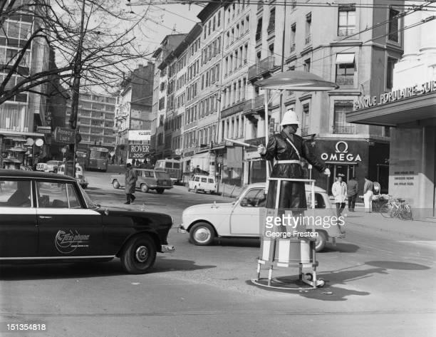 A police officer directing traffic in Geneva Switzerland April 1965