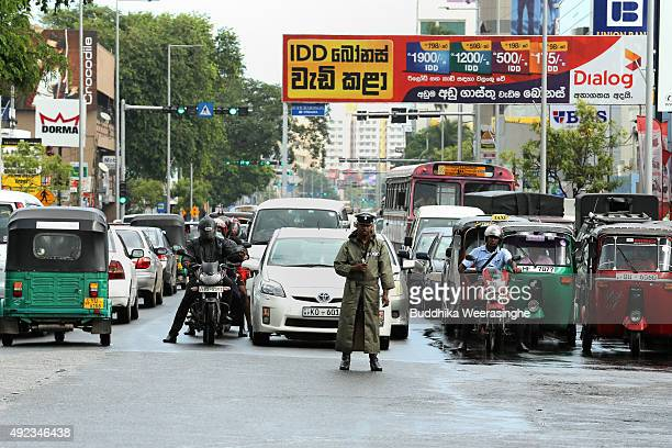 A police officer directs vehicle in a traffic jam at a junction on October 12 2015 in Colombo Sri Lanka The Sri Lankan government will seek Japanese...