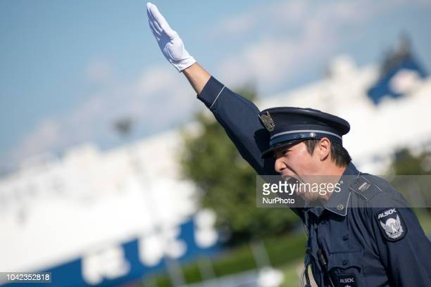 Police officer during at VSA a screening area for vehicles during a joint drill between Tokyo Organising Committee of the Olympic and Paralympic...