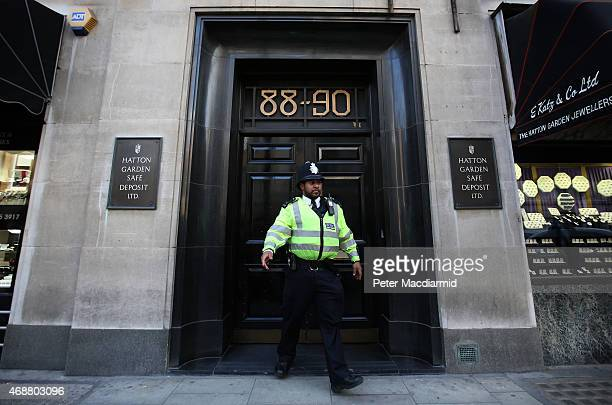 Police officer emerges from a Hatton Garden safe deposit centre on April 7, 2015 in London, England. Police are investigating a break in that occured...