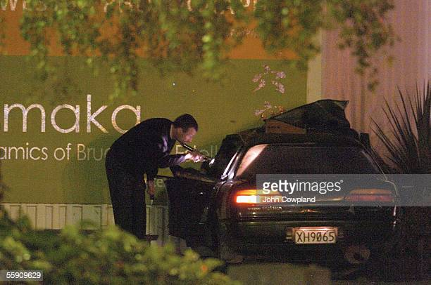 A police officer examines a car that crashed into the wall of the Hastings Exhibition Centre following a short police chase October 13 2005 in...