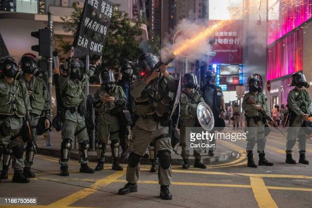 A police officer fires teargas at protesters on September 8 2019 in Hong Kong China Prodemocracy protesters have continued demonstrations across Hong...