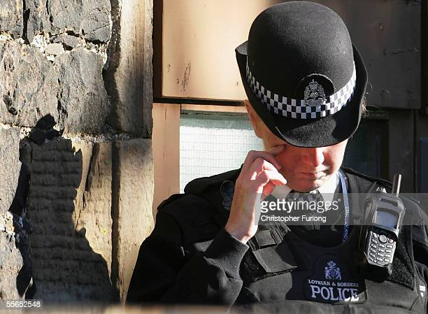 A police officer from Lothian and Borders police pays her respects during the the funeral of murdered schoolboy 11 year old Rory Blackhall on...