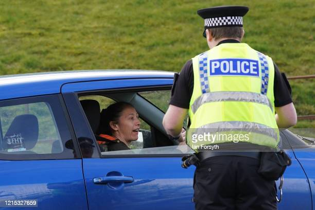 Police Officer from North Yorkshire Police reinforces the importance of social distancing and staying at home at a vehicle stop near Aysgarth Falls...