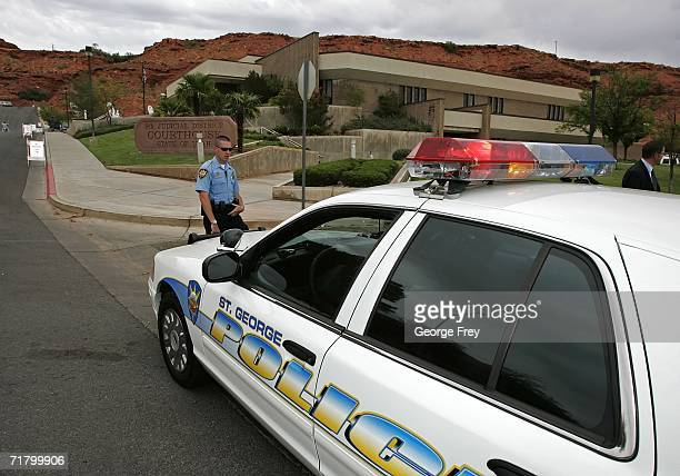 A police officer from the St George Police Department mans a road block outside the 5th Judicial District Courthouse during the first court hearing...