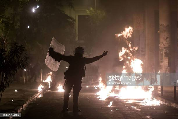 A police officer gestures during clashes within the demonstrations marking the 45th anniversary of 1973 student uprising against the military junta...