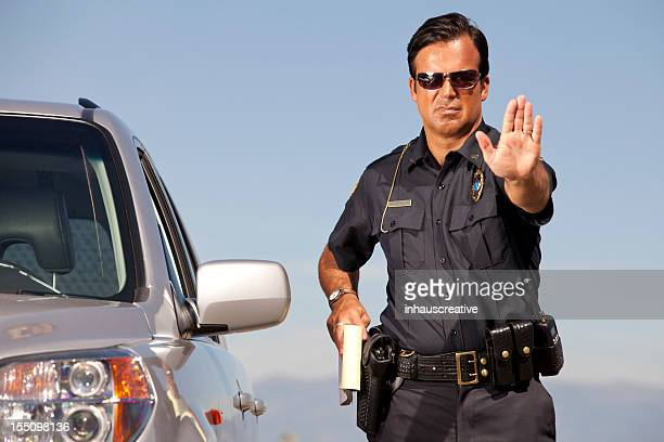 police officer gesturing halt - stop sign stock pictures, royalty-free photos & images