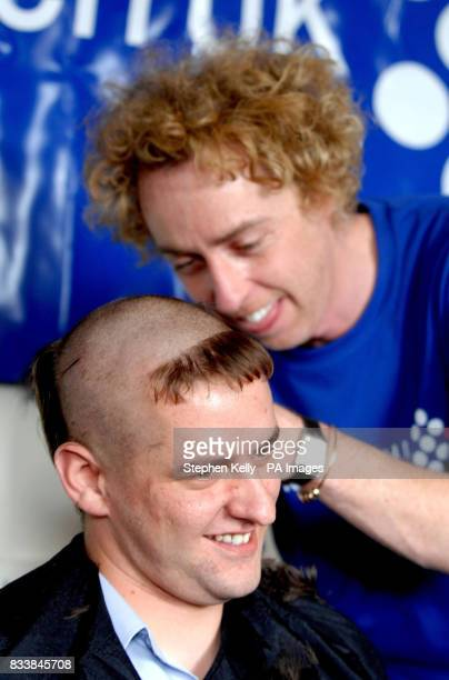 A police officer gets his head shaved by celebrity hairdresser James Brown at Kensington Police Station in west London to support a cancerstricken...