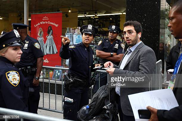 A police officer gives directions as roads are closed near the United Nations headquarters ahead of a visit by Pope Francis on September 25 2015 in...