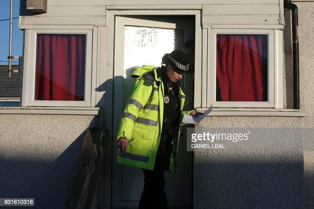A police officer gives information on flood risks to residents in Jaywick southeast England on January 13 2017 Seaside residents in southern England...