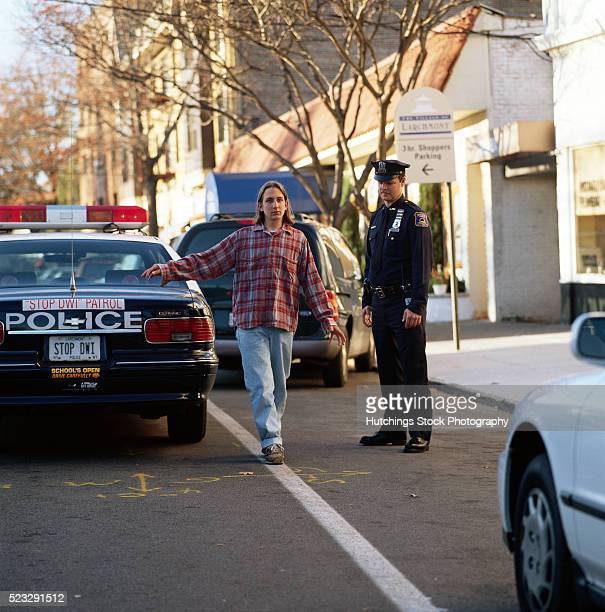 police officer giving a sobriety test - drinking and driving stock pictures, royalty-free photos & images