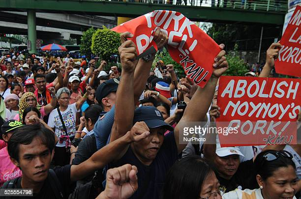 A police officer grabs the placard of a Filipino militant outside the Shrine of Mary where a prayer rally is being held in Quezon city Metro Manila...