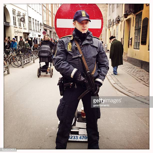 police officer guarding synagogue in copenhagen - guarding stock photos and pictures