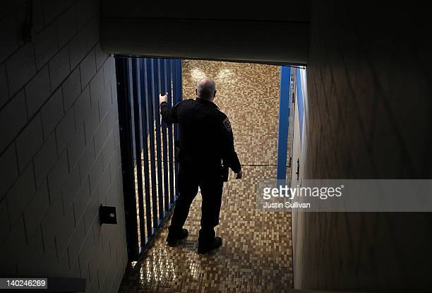 A police officer guards a hallway during a campaign rally for Republican presidential candidate former Massachusetts Gov Mitt Romney at Skyline High...