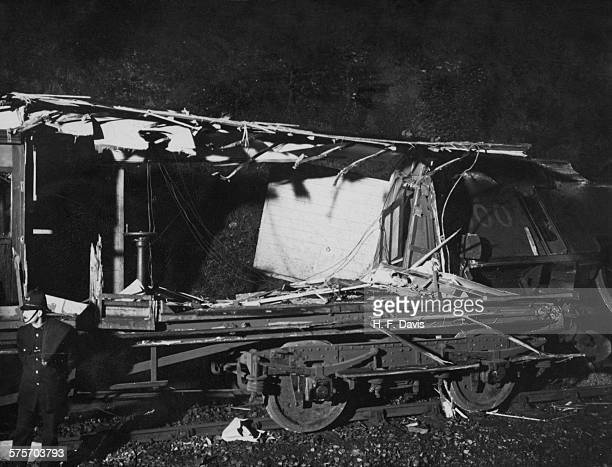 A police officer guards a wrecked carriage the day after the Sevenoaks railway accident 25th August 1927 The accident happened when the Southern...