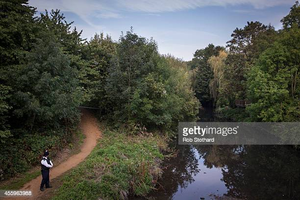 A police officer guards an area along the bank of the River Brent where police are searching for missing schoolgirl Alice Gross on September 23 2014...