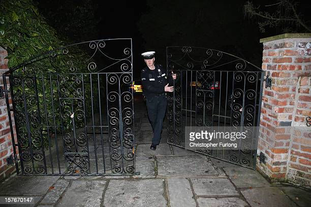 A police officer guards the Cheshire home of television and radio broadcaster Stuart Hall who has been charged with three counts of indecent assault...