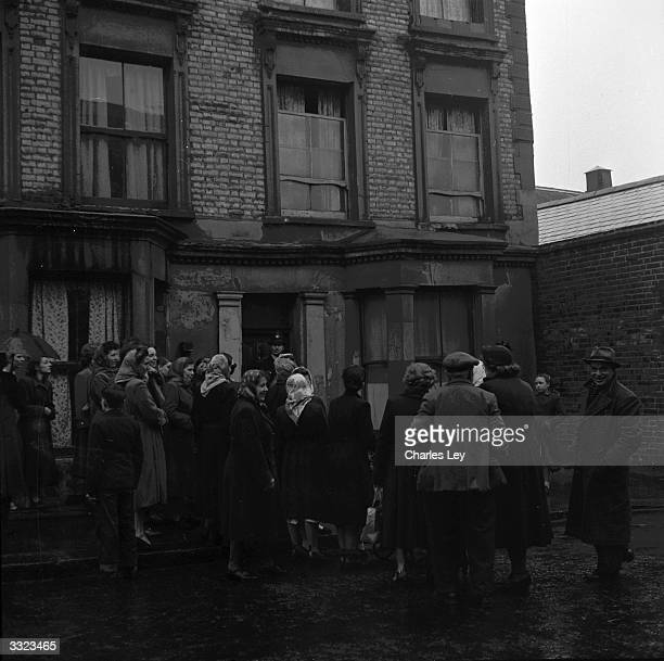 A police officer guards the entrance to 10 Rillington Place Notting Hill in London as crowds visit the house scene of several murders committed by...