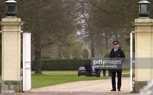 A police officer guards the entrance to All Saints Royal Chapel in Windsor Great Park 31 March 2002 following the death of Britain's Queen Mum who...