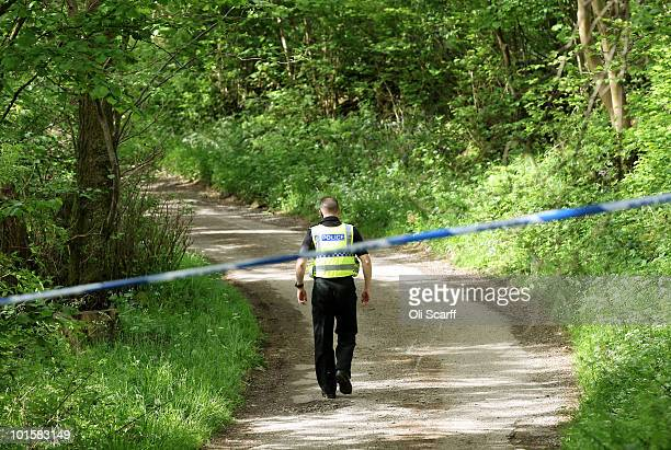 Police officer guards the entrance to Penny Hill Farm in the valley of Eskdale, near the village of Boot, where gunman Derrick Bird committed suicide...