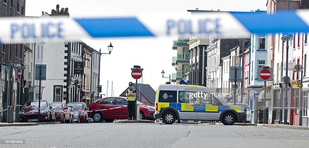 A police officer guards the scene of a shooting on Duke Street in Whitehaven, Cumbria, north west England on June 2, 2010. on June 2, 2010. A gunman killed at least 12 people after going on a rampage in a popular tourist area in northwest England on Wednesday, before apparently turning the gun on himself, police said. Some 25 people were injured when Derrick Bird, a 52-year-old taxi driver, spent nearly four hours driving through the Lake District, reportedly shooting at people from his car window.