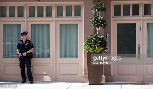 A police officer guards the townhouse in the Tribeca area of Manhattan where former IMF head Dominique StraussKahn is being held under house arrest...