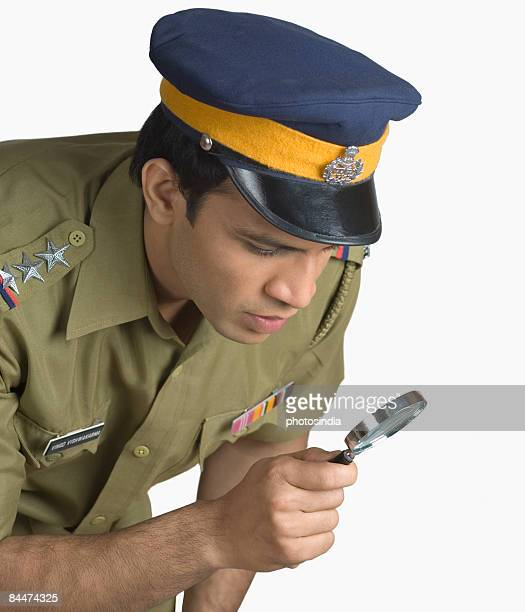 Police officer holding a magnifying glass